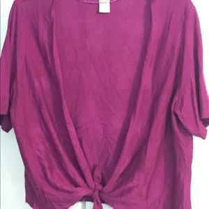 Short sleeved purple shrug can be tied in front